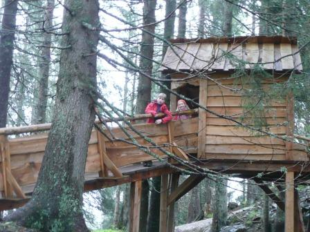 Wooden playhouse in the forest for children